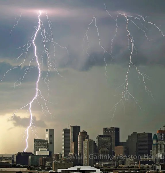 Lightning strikes over Boston's Financial and Seaport Districts during Tuesday afternoon's thunderstorm activity.