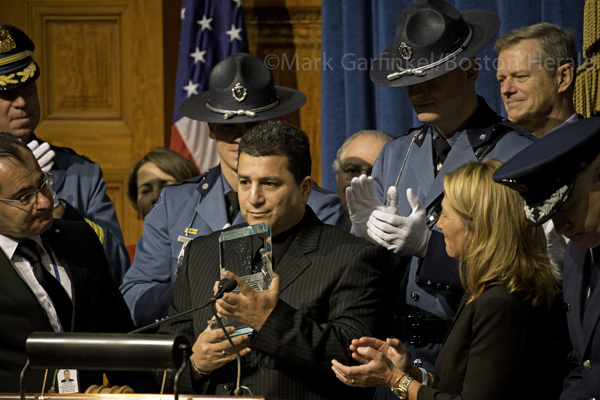 09/11/2015-Boston,MA. Albeiro Gomez, of Worcester, is presented with the 14th annual Madeline Amy Sweeney Award, named for Sweeney, a flight attendant aboard American Airlines Flight 11 that was hijacked and crashed on September 11, 2001, at a Friday morning ceremony at the State House. Staff Photo by Mark Garfinkel