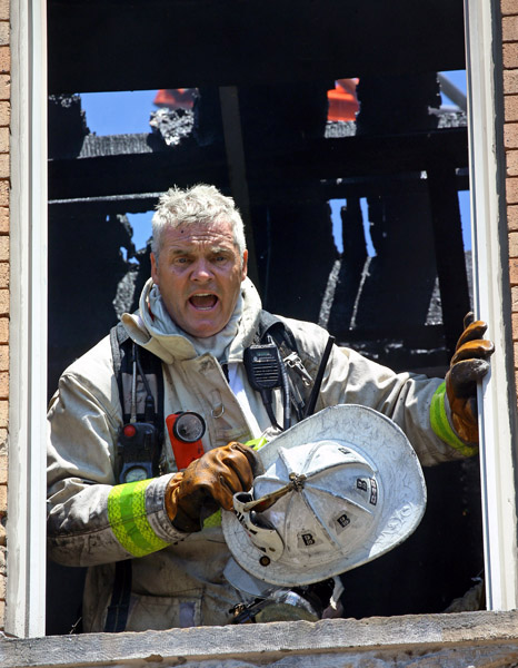 08/07/2015-Boston,MA. Joe Casper, Boston fire dept. acting District Chief, works at the scene of a 3 alarm fire at 6 Waverly St. in Roxbury today.