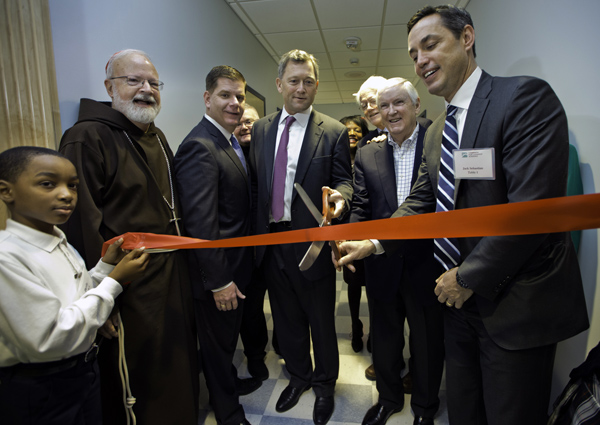 12/02/2015-Boston,MA. Student Devin Allen, Cardinal Sean O'Malley, Mayor Martin J. Walsh, Robert Atchinson, Peter Lynch, Jack Connors, and Jack Sebastian cut the ribbon on the re-dedication of Saint John Paul 11 Catholic Academy Lower Mills Campus, on Dorchester Ave. Staff photo by Mark Garfinkel