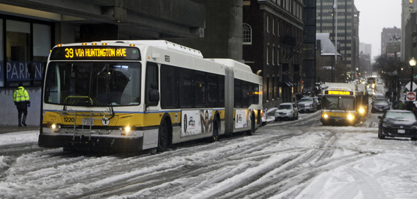 12/29/2015-Boston,MA. One bus that was stuck and two at the rear that had driven into the traffic jam, are seen disabled during Tuesday morning's snowfall. The buses, on Clarendon St. between Columbus and St. James, were stuck for approximately one hour. Staff photo by Mark Garfinkel