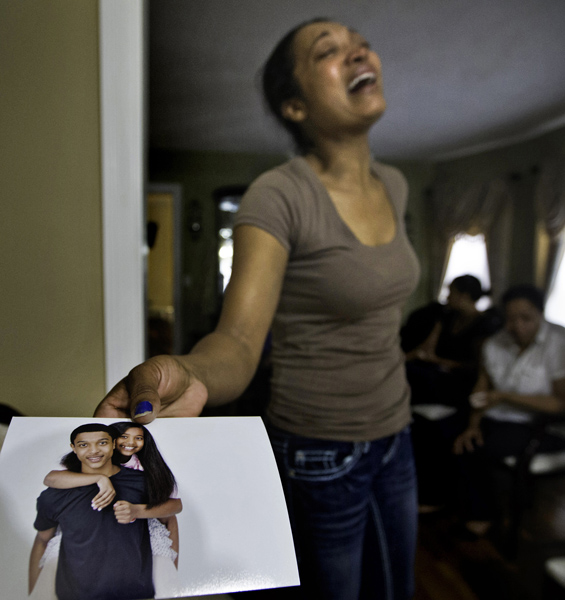 06/11/15-Boston,MA. Laura Dos Santos, the mother of 16 year old shooting victim Jonathan Dos Santos, holds a photo of him with his sister, in better times. Jonathan was shot dead last night.