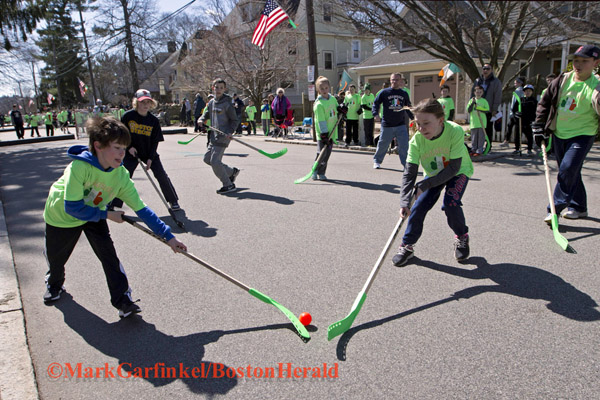 04/09/2016-Boston,MA. Area children compete at the annual Shamrock Shootout Street Hockey Tournament on Temple St. in the West Roxbury section of the city, Saturday morning. Staff photo by Mark Garfinkel