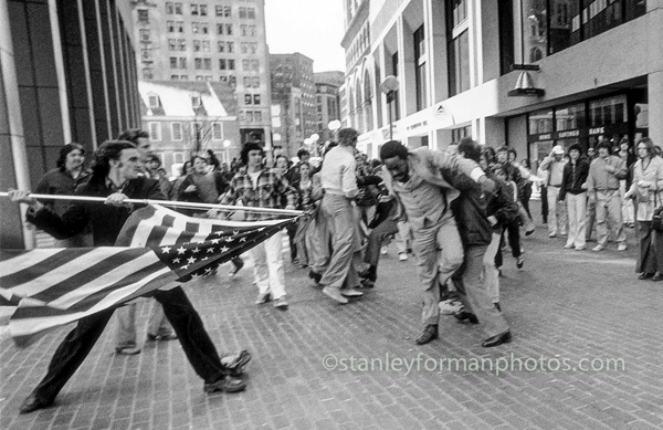 an analysis of the flag in the plaza a photograph by stanley forman 10 pulitzer prize-winning photos and stanley forman took a photograph that who has armed himself with—of all things—an american flag.
