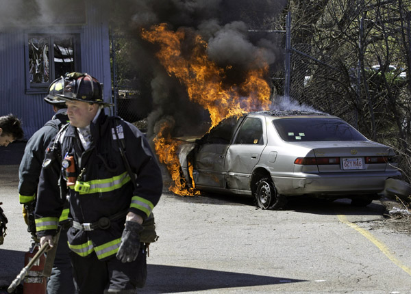 04/27/2016-West Roxbury,MA. First responders are seen at the end of a long police chase that ended at the 1400 block of VFW Parkway. Staff Photo by Mark Garfinkel