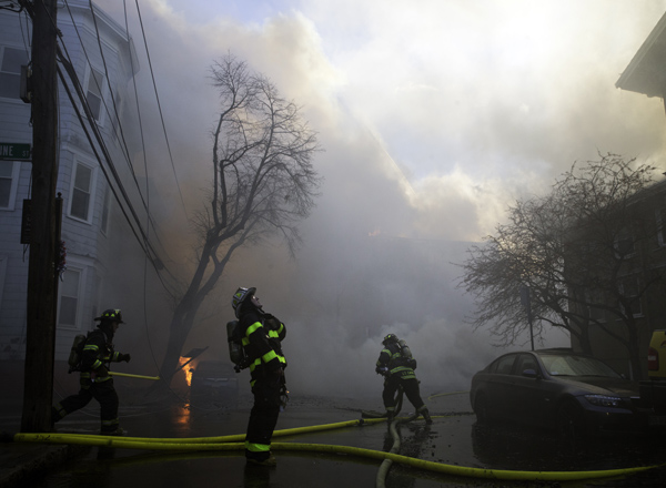 December 3, 2016-Cambridge,MA. Cambridge and surrounding fire departments battle a ten alarm fire on and around Berkshire street, Saturday afternoon. Staff photo by Mark Garfinkel