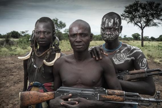 men holding guns