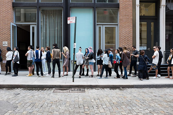 people waiting in line street photography