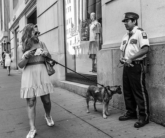 woman dog security guard street portrait