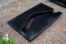 Melna granīta kapu apmale, daļēji slēgta