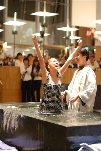 """This lady came out of the waters of rebirth screaming """"Hallelujah!"""" Would that we all found such joy in Christ."""