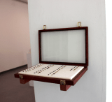 """Lana Abu-Shamat - """"35 Original 35 Replicates,"""" 2014, Coffee beans from Nablus, Palestine, self-hardening clay, English and Arabic numeral labeling, collectibles display case, linen, 18 x 12 x 2 inches."""