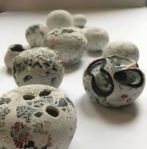 "Darina Karpov - ""Orbs of perfect song into our deep, dear silence,"" 2019, Porcelain with underglaze and glaze, dimensions ranging from 2.5–5 inch diameter"