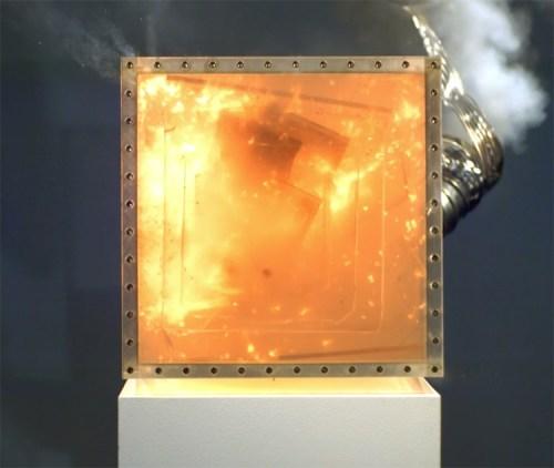 """Jonathan Schipper - """"Explosion (Video still),"""" 2015, Plexiglass, gunpowder, reinforcement bolts, exhaust vent, 14 x 14 x 14 inches. Series of 7"""