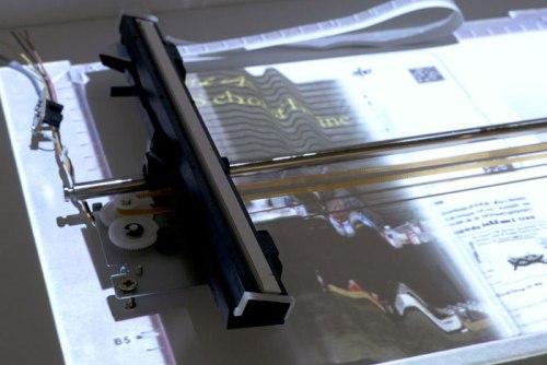 "Daniel Canogar  (bitforms gallery) - ""CIS,"" 2014, Discarded scanner parts, wood, projector, multimedia player 53 x 23.6 x 15 in / 134.6 x 60 x 38 cm video loop: 3 min, 21 sec"