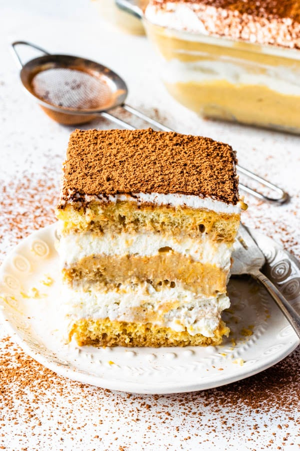pumpkin tiramisu slice with cocoa powder dusted on top