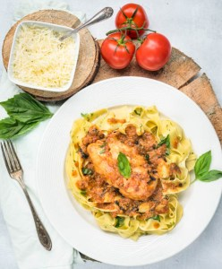 fresh basil pasta with tomato cream chicken