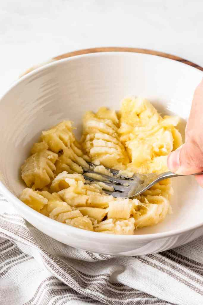 mashing banana with a fork