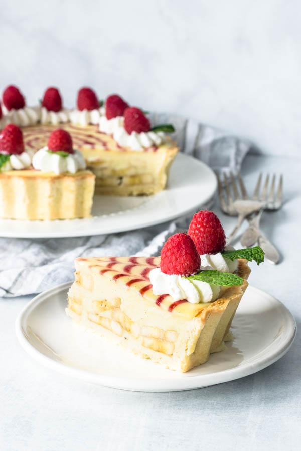 slice of banana cream and raspberry jam pie