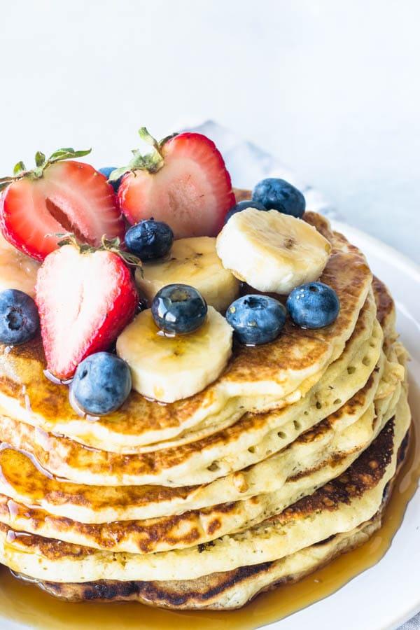 banana sourdough pancake stack with fresh fruit