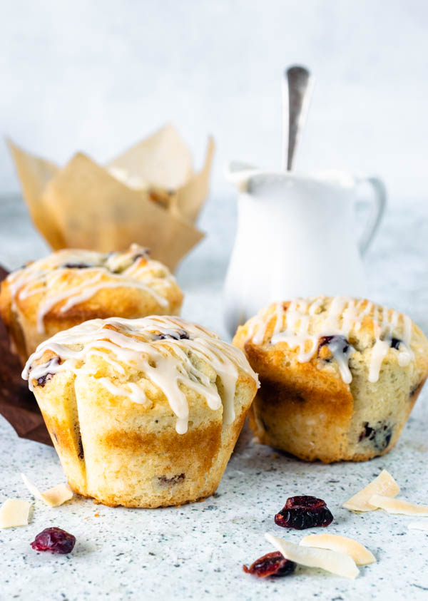 coconut and cranberry muffins with maple glaze