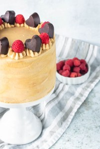 Peanut Butter and jelly cake, topped with chocolate hearts and raspberries