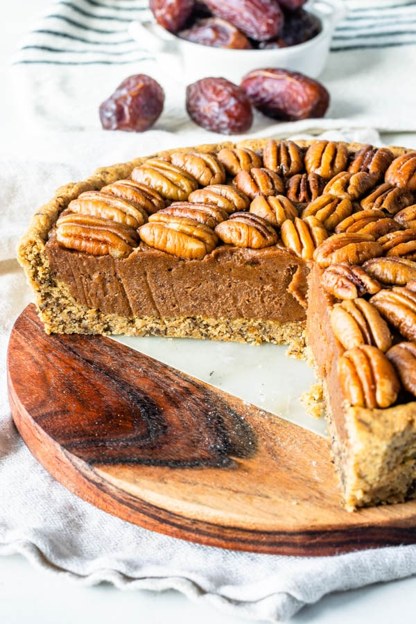 vegan pecan pie topped with pecans sliced