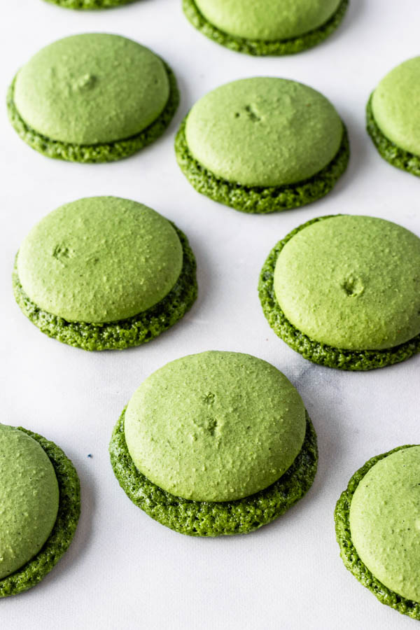 vegan matcha macaron shells with huge feet