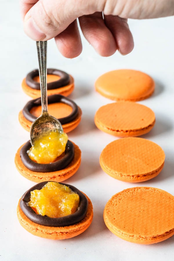 filling macarons with orange marmalade