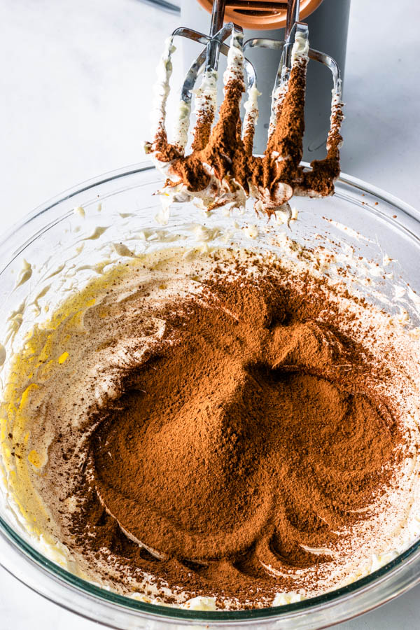 cocoa powder added to creamed butter to make sweet condensed milk frosting
