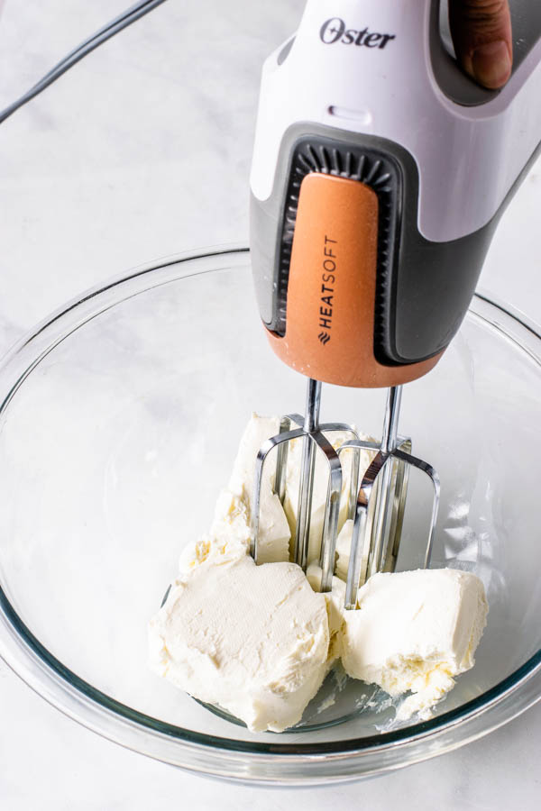 creaming cream cheese with an electric mixer