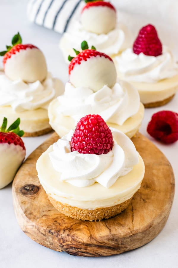 No-Bake White Chocolate mini Cheesecake topped with whipped cream and berries