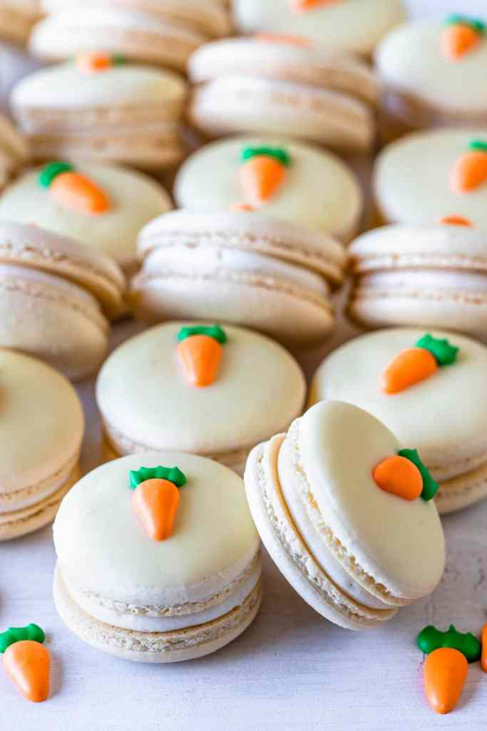 Carrot Cake Macarons topped with a royal icing carrot