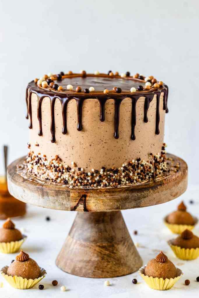 Dulce de Leche Mocha Cake with ganache drip topped with crispearls and dulce de leche