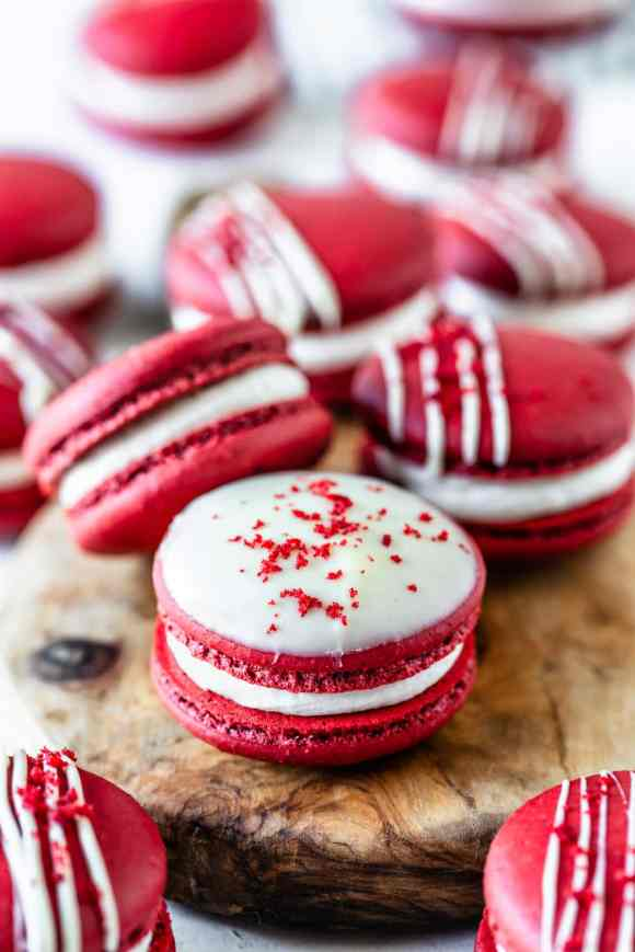 Red Velvet Macarons drizzled with white chocolate topped with red velvet cake crumbs
