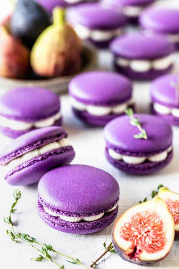 purple macarons filled with fig jam and buttercream, with thyme as a garnish on top, and figs on the picture as well, to decorate.