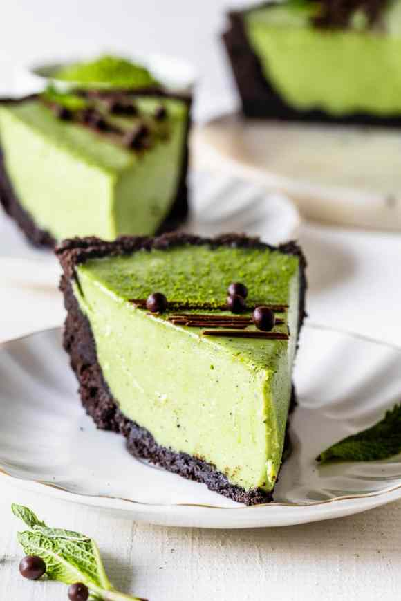 slice of Matcha Pie with oreo crust and drizzled with chocolate and callebaut crispearls