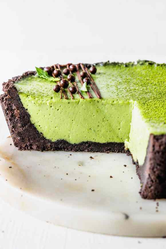 green tea Pie with oreo crust and drizzled with chocolate and callebaut crispearls sliced