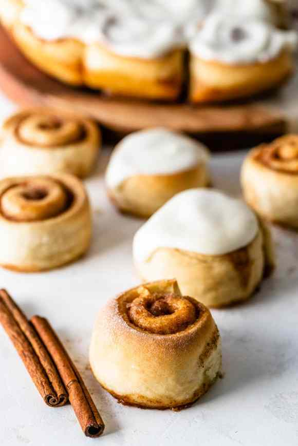 Mini Cinnamon Rolls without glaze, with some rolls with glaze on the back.