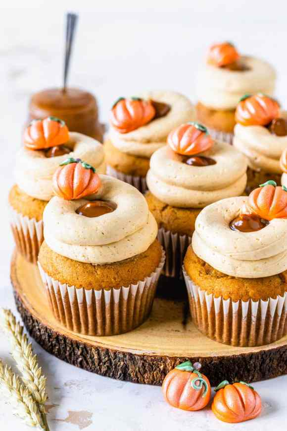 Dulce de Leche Pumpkin Cupcakes topped with a little pumpkin and with a russian buttercream.