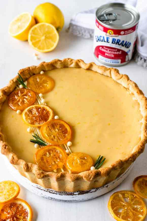 Lemon Pie with Condensed Milk topped with caramelized lemons and rosemary sprigs.