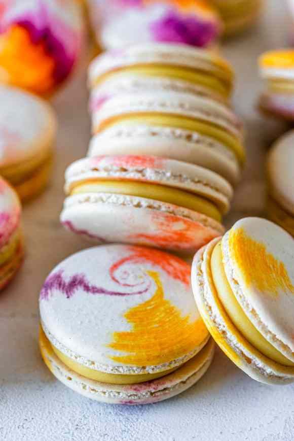 Passionfruit Macarons with Passionfruit Ganache and tie dye shells.