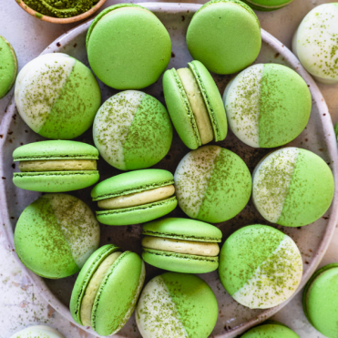 matcha macarons in a plate.