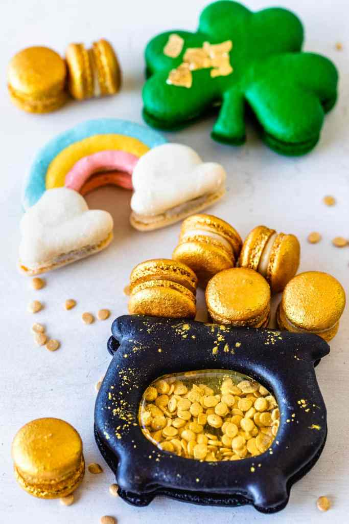 shamrock macaron, rainbow macarons and macarons shaped like pots of gold, filled with gold sprinkle coins, and with mini gold macarons.