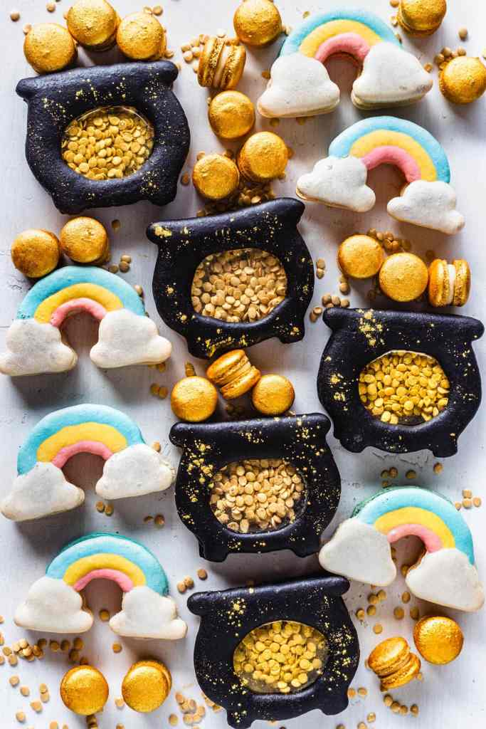 rainbow macarons and macarons shaped like pots of gold, filled with gold sprinkle coins, and with mini gold macarons.