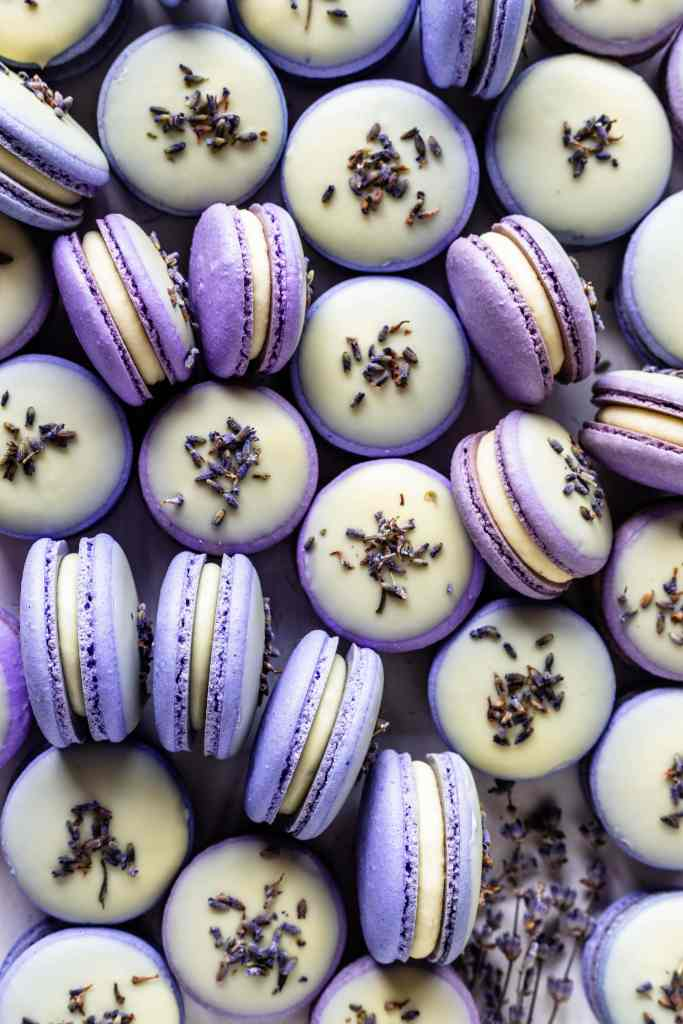 Lavender Macarons dipped in white chocolate and topped with lavender buds.