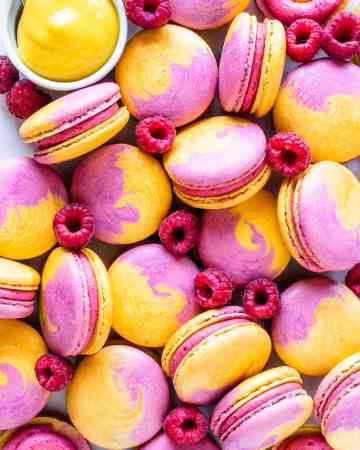 Mango Raspberry Macarons with bicolor shells pink and yellow.