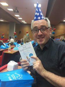 Iain Grant wearing party hat