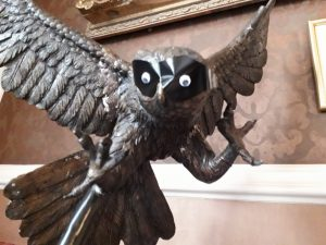 Statue of owl with Zorro mask