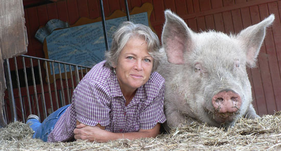 Judy of Pig's Peace Sanctuary with Curly the Pig.